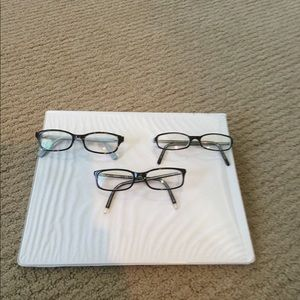 3 pair of glasses. They are prescription